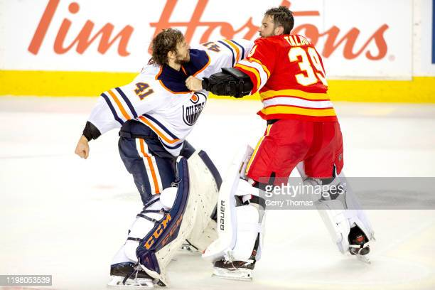 Mike Smith of the Edmonton Oilers fights Cam Talbot of the Calgary Flames at Scotiabank Saddledome on February 01 2020 in Calgary Canada
