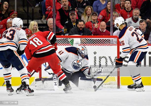 Mike Smith of the Edmonton Oilers makes a save against the Carolina Hurricanes during the third period of their game at PNC Arena on February 16 2020...