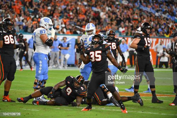 Mike Smith of the Miami Hurricanes reacts to sacking Chazz Surratt of the North Carolina Tar Heels in the second during the game between the Miami...