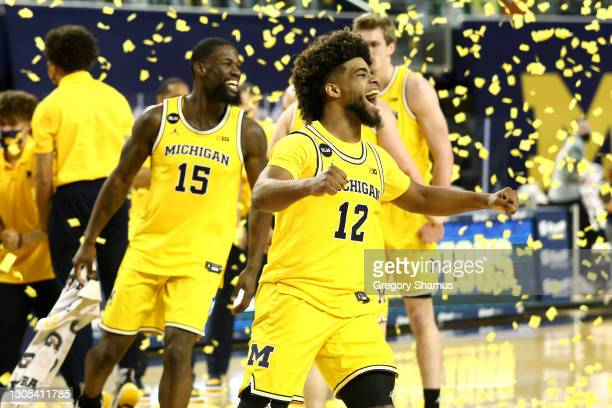 Mike Smith of the Michigan Wolverines celebrates his teams Big Ten championship with Chaundee Brown after defeating the Michigan State Spartans 69-50...