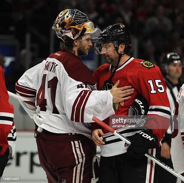 Mike Smith of the Phoenix Coyotes pats Andrew Brunette of the Chicago Blackhawks after Game Six of the Western Conference Quarterfinals during the...