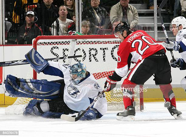 Mike Smith of the Tampa Bay Lightning makes a save against Antoine Vermette of the Ottawa Senators at Scotiabank Place on December 13 2008 in Ottawa...