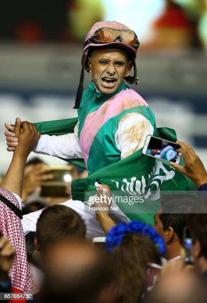 Mike Smith riding Arrogate celebrates winning the Dubai World Cup Sponsored By Emirates Airline during the Dubai World Cup at the Meydan Racecourse...