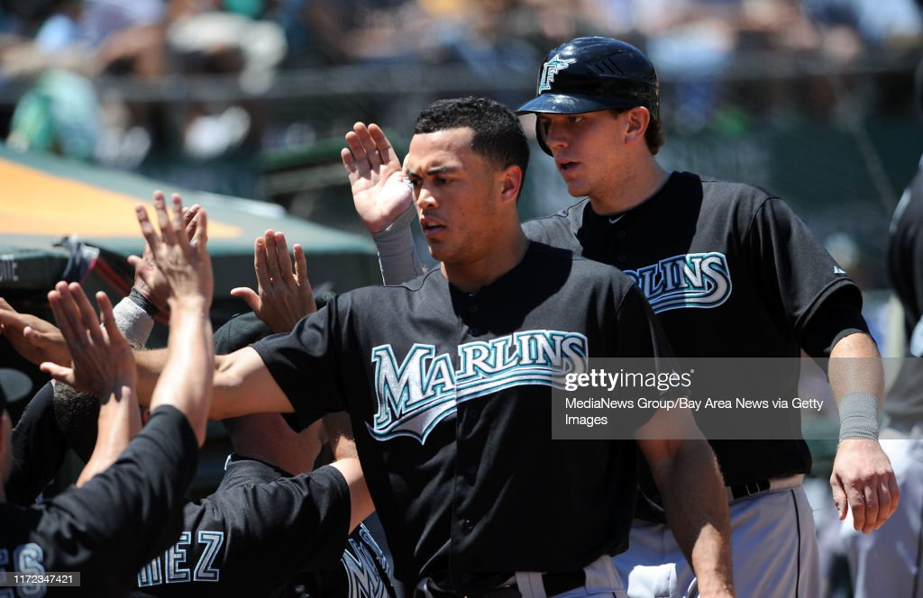 Mike Stanton (l) and Logan Morrison of the Florida Marlins scored on a fifth inning two-run double by John Buck as the Florida Marlins continued their victorious ways, winning 5-4 Thursday June 30, 2011 at the O.co Coliseum in Oakland, Calif.  (Karl Mondo : News Photo