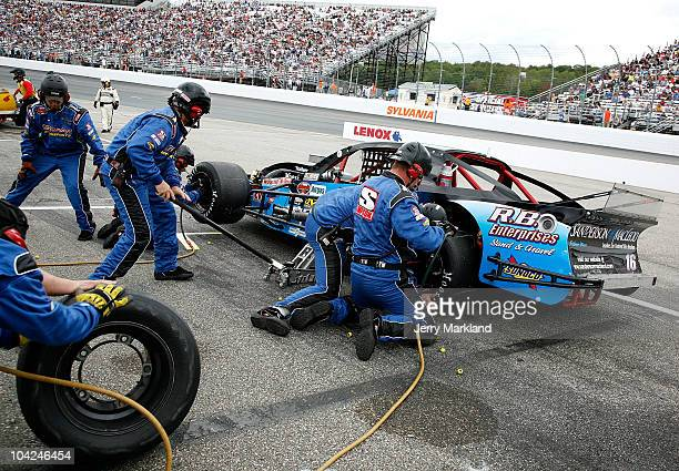 Mike Stefanik driver of the Diversified Metals/RB Enterprises Pontiac comes in for a pit stop during the NASCAR Whelen Modified Tour FW Webb 100 at...