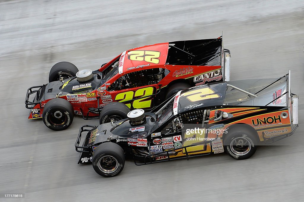 Mike Stefanik, driver of the #22 Robert B. Our Co./Canto & Sons Paving Ford races with Todd Szegedy, driver of the #2 UNOH/Dunleavy Repair Ford during the TitanRoof 150 at Bristol Motor Speedway on August 21, 2013 in Bristol, Tennessee.