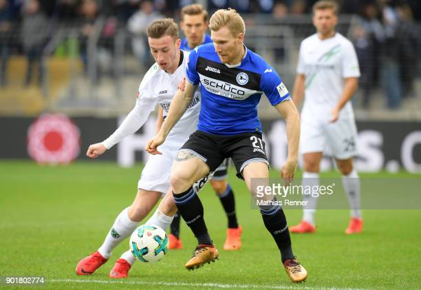Mike Steven Baehre of Hannover 96 and Andreas Voglsammer of Arminia Bielefeld during the test match between Arminia Bielefeld and Hannover 96 on...