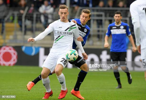 Mike Steven Baehre of Hannover 96 and Konstantin Kerschbaumer of Arminia Bielefeld during the test match between Arminia Bielefeld and Hannover 96 on...