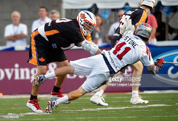 Mike Stone of the Boston Cannons gets crossed checked as he tries to get the ball to a teammate against the Toronto Nationals on July 24 2010 at...
