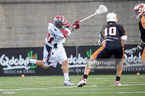 Mike Stone of the Boston Cannons lets a shot fly against Kyle Rubisch and the Toronto Nationals on July 24 2010 at Harvard Stadium in Boston...