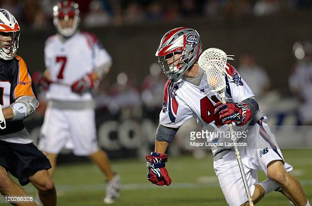 Mike Stone of the Boston Cannons tries to get low as he drives left against the Toronto Nationals on July 24 2010 at Harvard Stadium in Boston...