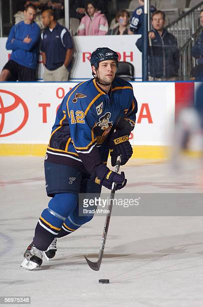 Mike Stuart of the Peoria Rivermen skates with the puck against the Toronto Marlies at Ricoh Coliseum on February 3 2006 in Toronto Ontario Canada...