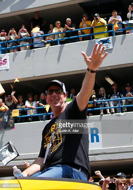 Mike Sullivan of the Pittsburgh Penguins celebrates during the Victory Parade and Rally on June 15 2016 in Pittsburgh Pennsylvania The Penguins...