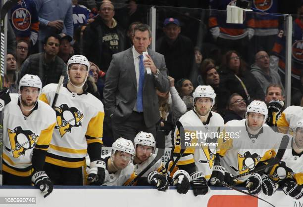 Mike Sullivan of the Pittsburgh Penguins handles bench duties against the New York Islanders at NYCB Live at the Nassau Coliseum on December 10 2018...