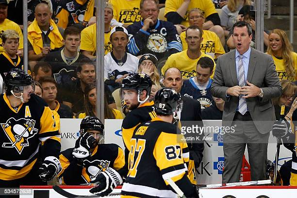 Mike Sullivan of the Pittsburgh Penguins talks with his team against the Tampa Bay Lightning during the second period in Game Seven of the Eastern...