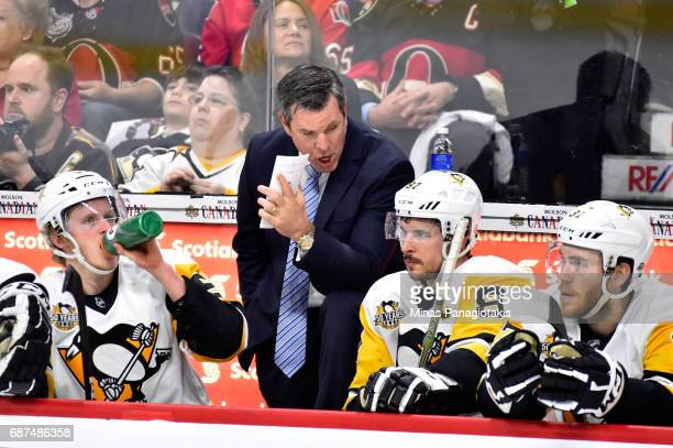 Mike Sullivan of the Pittsburgh Penguins talks with Sidney Crosby on the bench against the Ottawa Senators during the first period in Game Six of the...