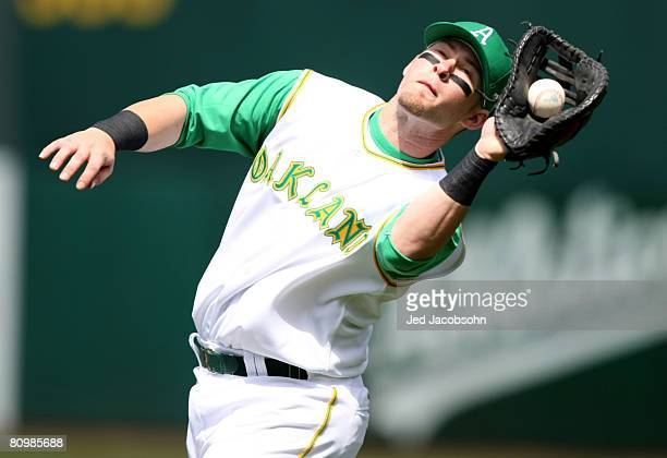 Mike Sweeney of the Oakland Athletics catches a ball hit by Chris Shelton of the Texas Rangers on May 4 2008 at McAfee Coliseum in Oakland California