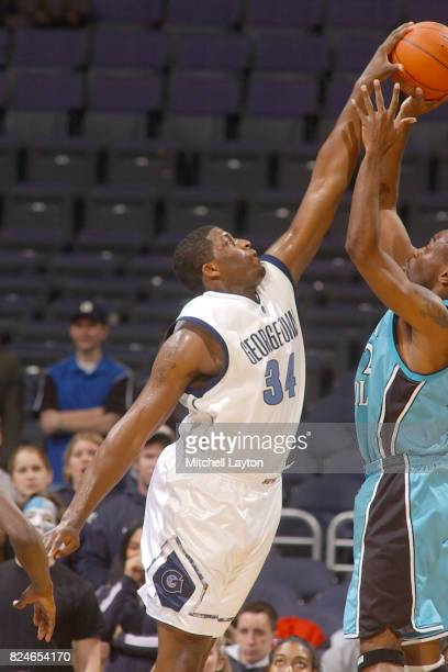 Mike Sweetney of the Georgetown Hoyas blocks a shot during a college basketball game against the Coastal Carolina Chanticleers at MCI Center on...