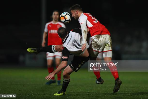 Mike Symons of Hereford is fouled by Baily Cargill of Fleetwood during the Emirates FA Cup second round replay match between Hereford FC and...
