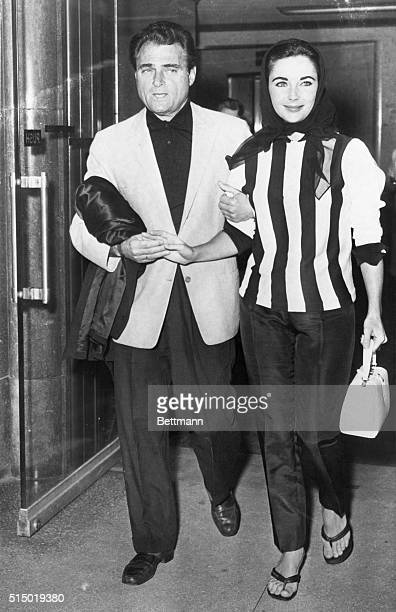 Mike Takes the Mrs Home Hollywood California Producer Mike Todd lends an assist to his wife actress Elizabeth Taylor as she leaves Cedars of Lebanon...