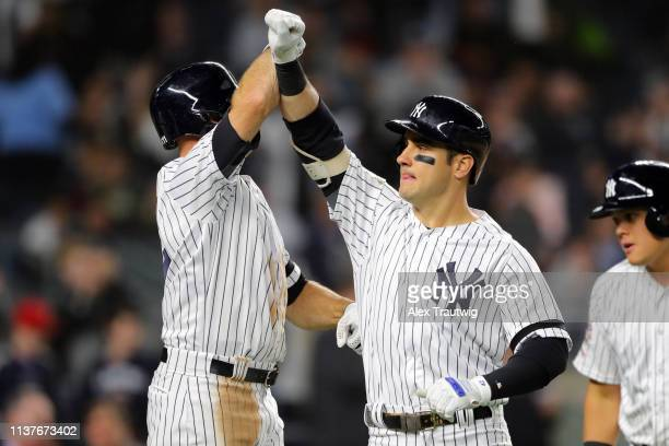 Mike Tauchman of New York Yankees is greeted by teammate Brett Gardner after hitting a tworun home run in the sixth inning during the game between...