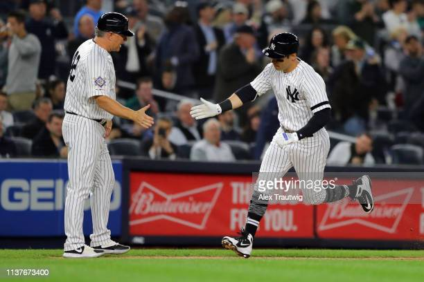 Mike Tauchman of New York Yankees rounds the base after hitting a tworun home run in the sixth inning during the game between the Boston Red Sox and...