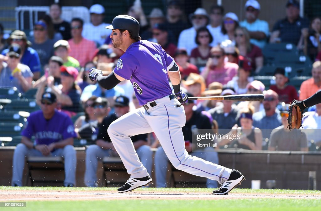 Mike Tauchman #3 of the Colorado Rockies follows through on a swing during the first inning of a spring training game against the Arizona Diamondbacks at Salt River Fields at Talking Stick on March 12, 2018 in Scottsdale, Arizona.