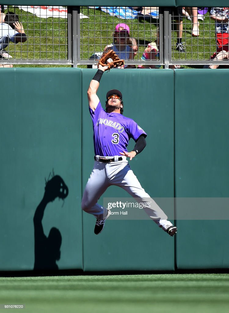 Mike Tauchman #3 of the Colorado Rockies makes a leaping catch during the first inning of a spring training game against the Arizona Diamondbacks at Salt River Fields at Talking Stick on March 12, 2018 in Scottsdale, Arizona.