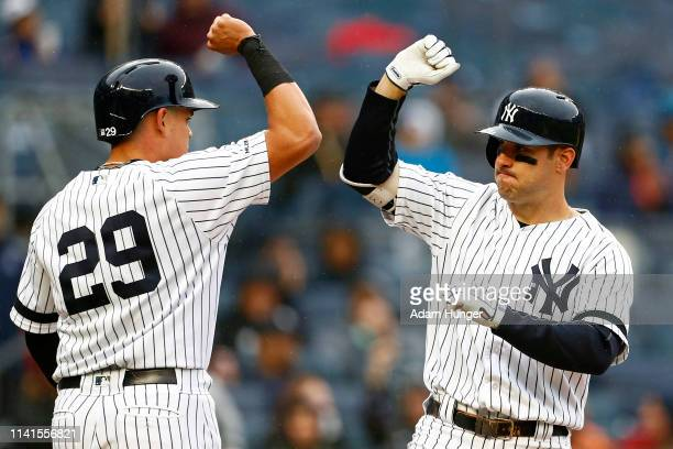 Mike Tauchman of the New York Yankees celebrates his tworun home run with Gio Urshela of the New York Yankees against the Minnesota Twins during the...