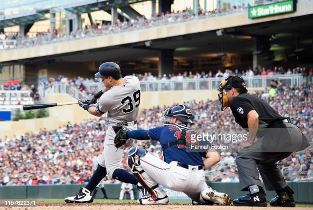 Mike Tauchman of the New York Yankees hits a two-run triple against the Minnesota Twins during the second inning of the game on July 24, 2019 at...