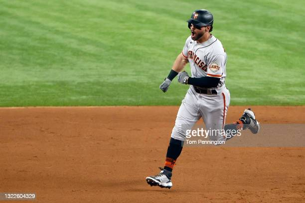 Mike Tauchman of the San Francisco Giants celebrates while rounding the bases after hitting a grand slam home run against the Texas Rangers in the...