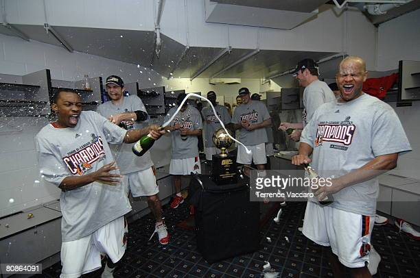 Mike Taylor Luke Jackson and Randy Livingston of the Idaho Stampede celebrate in the locker room after winning Game Three of the DLeague Finals...