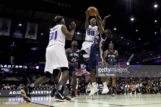 Mike Taylor of the Ghost Ballers attempts a shot while being guarded by Nate Robinson of Tri-State in the first half during week seven of the BIG3...