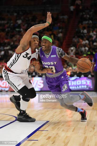 Mike Taylor of the Ghost Ballers drives to the basket against David Hawkins of Trilogy during week eight of the BIG3 three on three basketball league...
