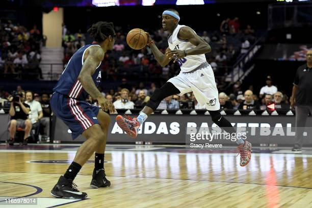 Mike Taylor of the Ghost Ballers passes the ball while being guarded by Amar'e Stoudemire of Tri-State in the second half during week seven of the...