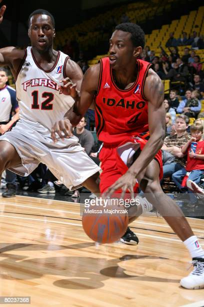 Mike Taylor of the Idaho Stampede drives the ball against Andre Ingram of the Utah Flash on March 13 2008 at the David O McKay Events Center in Orem...