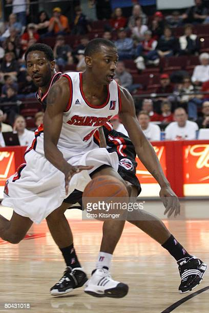 Mike Taylor of the Idaho Stampede drives to the basket past Kevin Sweetwyne the Utah Flash during the DLeague game on March 29 2008 at Qwest Arena in...