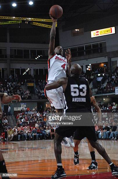 Mike Taylor of the Idaho Stampede goes to the basket against Serge Angounou of the Austin Toros during Game Three of the DLeague Finals on April 25...