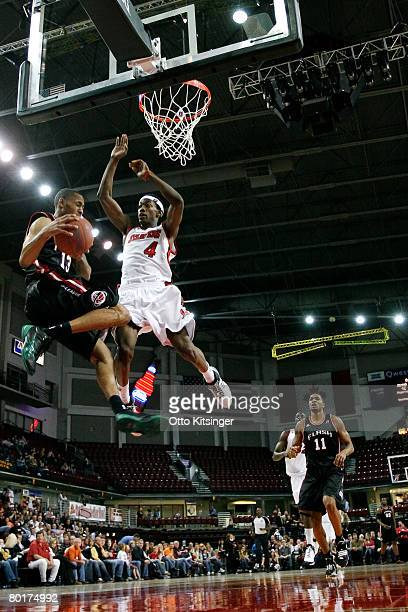 Mike Taylor of the Idaho Stampede goes up against Gabe Pruitt of the Utah Flash during the DLeague game at Qwest Arena March 8 2008 in Boise Idaho...