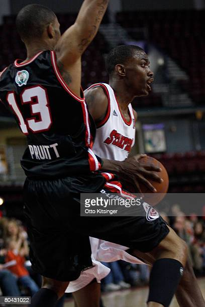 Mike Taylor of the Idaho Stampede looks to the basket against Gabe Pruitt of the Utah Flash during the DLeague game on March 29 2008 at Qwest Arena...