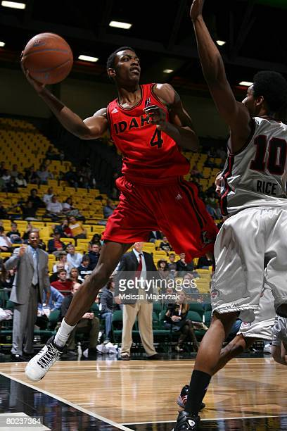 Mike Taylor of the Idaho Stampede passes the ball around Lamar Rice of the Utah Flash on March 13 2008 at the David O McKay Events Center in Orem...