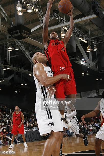 Mike Taylor of the Idaho Stampede shoots against Darvin Ham of the Austin Toros in Game One of the DLeague Finals at the Austin Convention Center on...