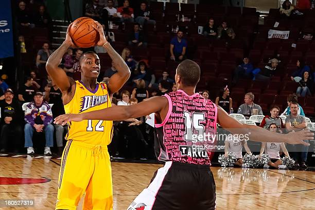 Mike Taylor of the Los Angeles DFenders looks for a pass over Seth Tarver of the Idaho Stampede during the NBA DLeague game on February 1 2013 at...