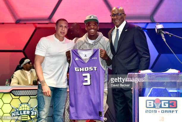 Mike Taylor poses with Ghost Ballers captain Mike Bibby and BIG3 Commissioner Clyde Drexler after being drafted at by the Ghost Ballers in the third...