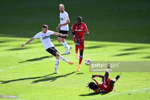Mike te Wierik of Derby County tackles Lucas Joao of Reading FC during the Sky Bet Championship match between Derby County and Reading at Pride Park...