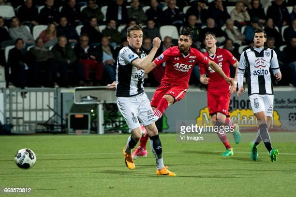 Mike te Wierik of Heracles Almelo Alireza Jahanbakhsh of AZ Wout Weghorst of AZ Justin Hoogma of Heracles Almelo 02during the Dutch Eredivisie match...