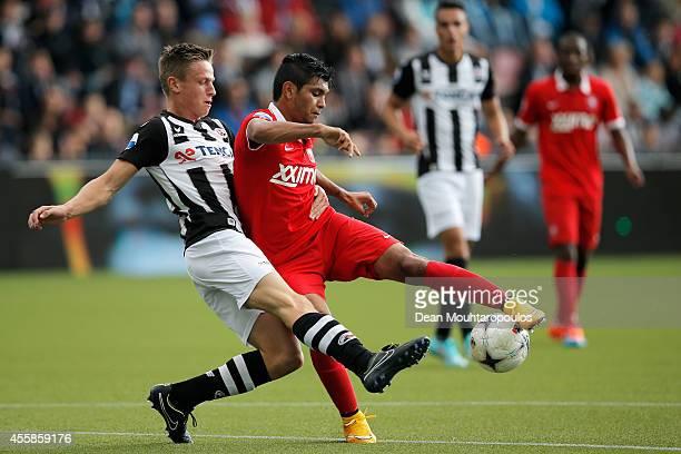 Mike te Wierik of Heracles tackles Jesus Corona of Twente during the Dutch Eredivisie match between Heracles Almelo and FC Twente at Polman Stadion...