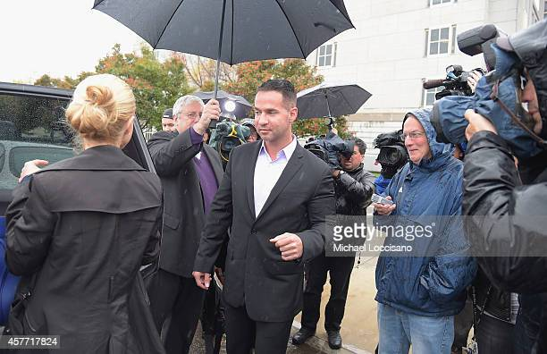 "Mike ""The Situation"" Sorrentino and fiancee Lauren Pesce appear for Sorrentino's arraignment on tax fraud charges at the Martin Luther King Building..."