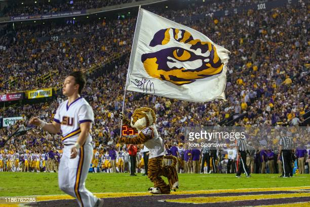 Mike the Tiger runs an LSU flag through the end zone during a game between the LSU Tigers and the Texas A&M Aggies on November 30 at Tiger Stadium in...