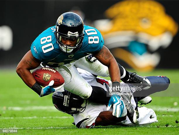 Mike Thomas of the Jacksonville Jaguars is tackled by Brice McCain of the Houston Texans during the game at Jacksonville Municipal Stadium on...